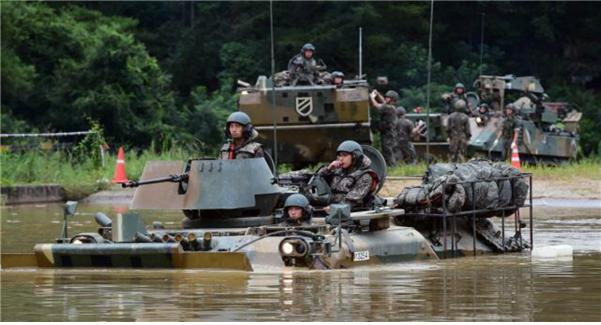 Flowing like water Mechanized unit performs a perfect river crossing operation